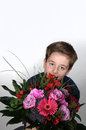 Boy with flowers giving a beautiful bunch of as present Royalty Free Stock Photo