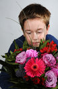 Boy with flowers giving a beautiful bunch of as present Royalty Free Stock Photography