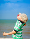 Boy flying kite at the beach a a Royalty Free Stock Photography