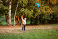 Boy flying a kite in a clearing in the forest, Royalty Free Stock Photo