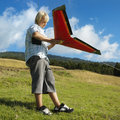 Boy flying remote controlled airplane. Royalty Free Stock Photo