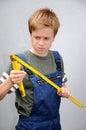 Boy with folding ruler Royalty Free Stock Photo
