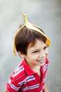 Boy fooling around wearing banana peel on his head Royalty Free Stock Image