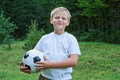 Boy football player with ball. Royalty Free Stock Photo