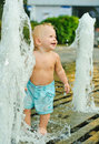 Boy and fountain Royalty Free Stock Photo