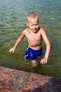 Boy at the fountain Royalty Free Stock Photo
