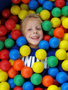 Boy in fun balls Stock Images