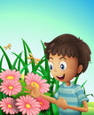 A boy in the garden with flowers and dragonflies Royalty Free Stock Photo