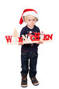 Boy with German Christmas greetings Royalty Free Stock Photo