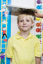 Boy Getting Height Measured By Teacher Royalty Free Stock Photography