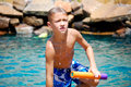 Boy getting out of swimming pool young dripping wet Stock Photos