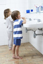 Boy and girl in bathroom brushing teeth Royalty Free Stock Image