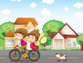 A boy and a girl biking followed by a dog illustration of Royalty Free Stock Image