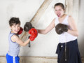 Boy and girl boxing Royalty Free Stock Photo