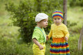 Boy with a girl in bright colored clothing love Royalty Free Stock Image