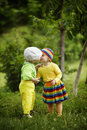 Boy with a girl in bright colored clothing love Stock Images