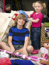 Boy girl brother sister having fun together cleaning messy garage attached to their home spring cleaning Stock Image