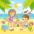 Boy and a girl are building a castle from the sand. Children playing on the beach by the sea. Royalty Free Stock Photo