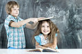 Boy and girl children indulge in school a lesson about the board Stock Image