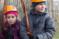 Boy and girl with climbing equipment ready for the passage of obstacles Stock Photography