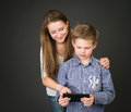 Boy and girl with digital tablet interested in technology Stock Images