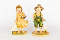 Boy and girl dolls with ducks Royalty Free Stock Image