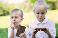 Boy and girl eating chocolate bar Royalty Free Stock Photo