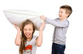 Boy and girl fighting pillow pillows isolated on white background Stock Photos