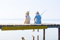 Boy and girl with fishing rods Royalty Free Stock Photo