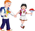 Boy and girl with flowers go to school Royalty Free Stock Photo