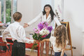 Boy and girl give flowers as a school teacher in teacher x s day children Stock Photography
