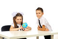 Boy and girl with globe isolated in studio Stock Photo