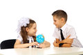 Boy and girl with globe isolated in studio Stock Image