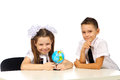 Boy and girl with globe isolated in studio Royalty Free Stock Image