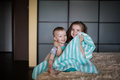 Boy and girl hiding under the blanket