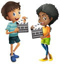 Boy and girl holding clapboard Royalty Free Stock Photo