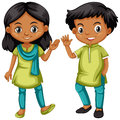 Boy and girl from India in green and blue outfit