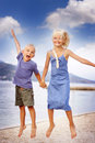 Boy and girl jumping Stock Photos