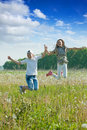 Boy and girl jumping at meadow Royalty Free Stock Photo