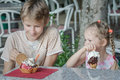 Boy and girl kids enjoying their Italian ice cream in gelateria Royalty Free Stock Photo