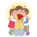 Boy and girl kissing mom giving kisses on mothers day carnation flower bouquet Royalty Free Stock Photos