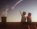 Boy and girl make a wish Royalty Free Stock Photo