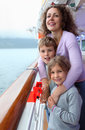 Boy and girl with mother stand on ship deck Stock Images