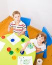 Boy and girl paint colors Royalty Free Stock Images
