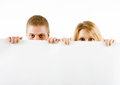 Boy and a girl peeking from a sheet Royalty Free Stock Photo