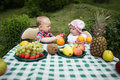 Boy and girl on picnic in park cute Stock Images
