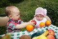 Boy and girl on picnic in park cute Stock Image
