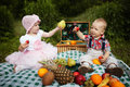 Boy and girl on picnic in park cute Royalty Free Stock Photo