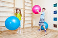 Boy and girl playing with balls Royalty Free Stock Photo
