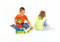 Boy and girl playing with a constructor Royalty Free Stock Photography